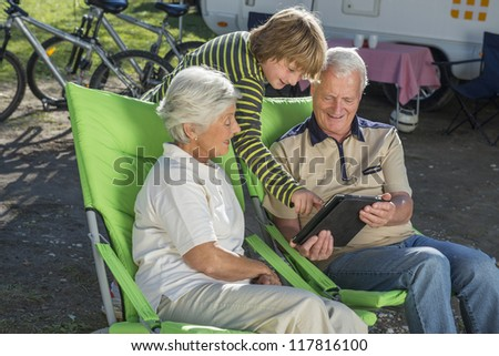 Sharing the wonders of technology - stock photo