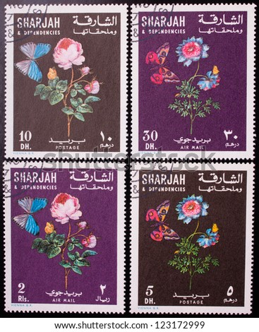 SHARJAH - CIRCA 1970: A stamp printed in Sharjah shows  four kinds of flowers and butterflies , circa 1970.