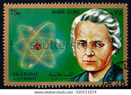 SHARJAH - CIRCA 1972: a stamp printed in the Sharjah UAE shows Marie Sklodowska Curie, and Diagram of Atom, circa 1972 - stock photo