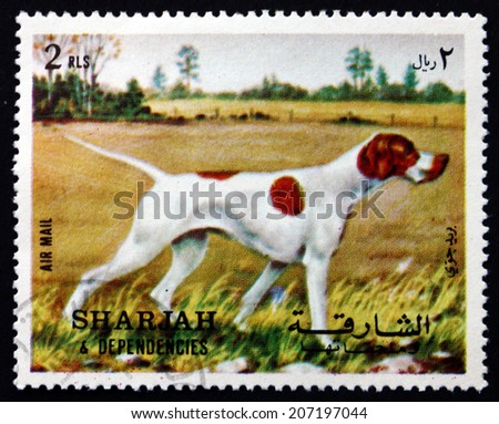SHARJAH - CIRCA 1972: a stamp printed in the Sharjah UAE shows Pointer, Dog Breed, circa 1972 - stock photo
