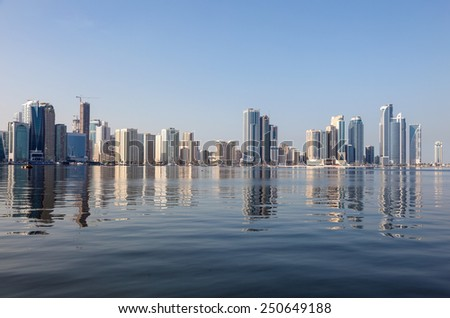 Sharjah City skyline reflecting in the creek. Sharjah, United Arab Emirates - stock photo