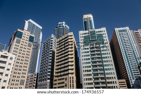 SHARJAH, UAE - OCTOBER 28,  2013: Modern buildings in Sharjah. It is the most industrialized emirate in UAE.