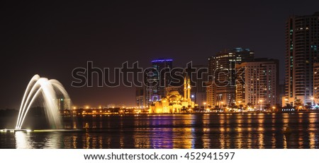 SHARJAH, UAE - OCTOBER 29, 2013: Musical fountain show. The Sharjah Fountain is one of the biggest fountains in the region.