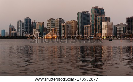 SHARJAH, UAE - OCTOBER 29: Night view of Sharjah, on October 29, 2013. Sharjah is located along northern coast of Persian Gulf on Arabian Peninsula