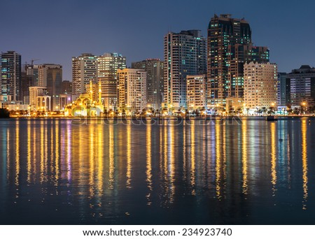 SHARJAH, UAE - OCTOBER 29: Night view of Sharjah, on October 29, 2013. Sharjah is located along northern coast of Persian Gulf on Arabian Peninsula - stock photo