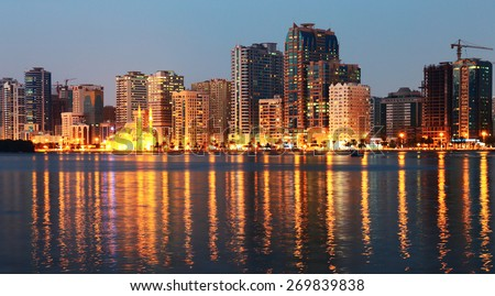SHARJAH, UAE - OCTOBER 29, 2013: Night view of Sharjah, Sharjah is located along northern coast of Persian Gulf on Arabian Peninsula