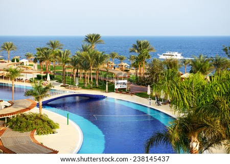 SHARM EL SHEIKH, EGYPT -  DECEMBER 3: The tourists are on vacation at popular hotel on December 3, 2013 in Sharm el Sheikh, Egypt. Up to 12 million tourists have visited Egypt in year 2013.