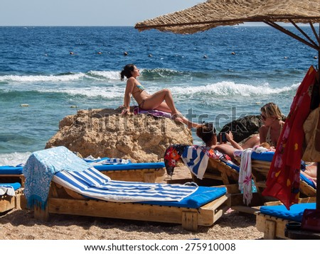 Sharm el-Sheikh, Egypt - February 28, 2013: tourists tan in the sun on the beach in Sharm el-Sheikh, scenes of relaxing on the beach in the month of February on the Red Sea in Egypt