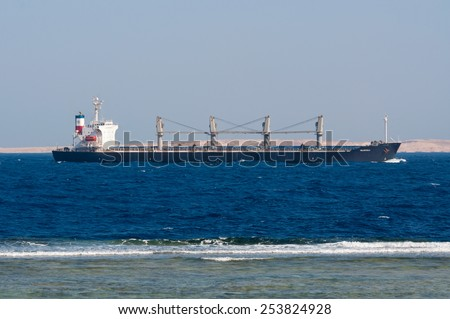 SHARM EL SHEIKH, EGYPT - NOVEMBER 21: Bulk Carrier Valopoula sails along the shore of the Red Sea near Sharm El Sheikh, Egypt at November 21, 2010. Type of vessel: Bulk Carrier. Flag: Bahamas. - stock photo