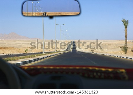 Sharm el Sheikh Egypt view through taxi windscreen - stock photo