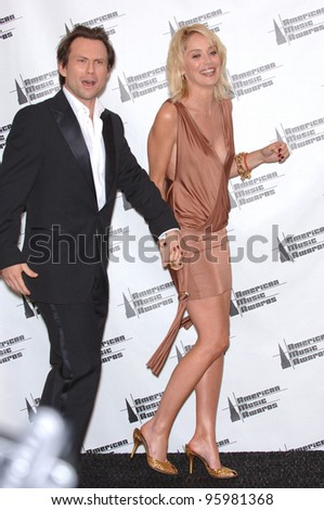 SHARON STONE & CHRISTIAN SLATER at the 2006 American Music Awards at the Shrine Auditorium, Los Angeles. November 21, 2006  Los Angeles, CA Picture: Paul Smith / Featureflash - stock photo