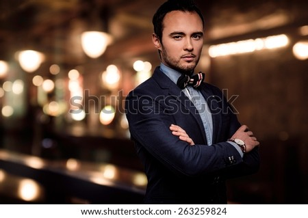Sharp dressed dandy fashionista in elite night club  - stock photo