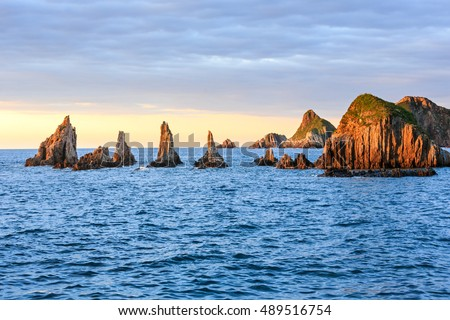 Sharp islets near Gueirua beach (Asturias, Spain). Evening Atlantic ocean landscape.