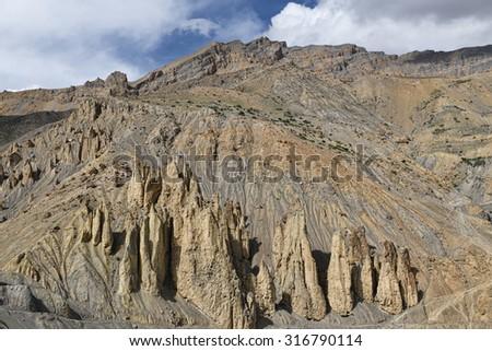 Sharp jugged vertical rocks - stock photo
