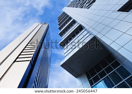 Sharp lines from modern architecture against a blue sky.