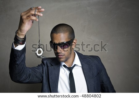Sharp modern man looks at his old pocket watch