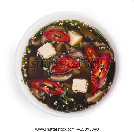 sharp pepper soup with tofu and mushrooms - stock photo