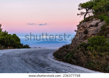 Sharp turn on the highway between the rocks, Greece, Attica  - stock photo
