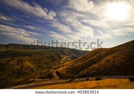 Sharp turns on a mountain road - stock photo