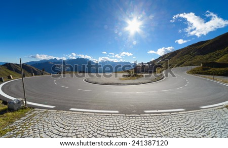 Sharp U-turn on Alpine road in Austria - stock photo