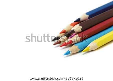 Sharpened colored pencils lying in a row.