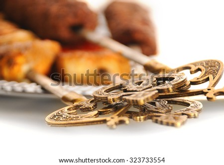 Shashlik and shish kebab on the plate with oriental decoration - stock photo