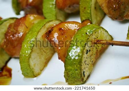 Shashlik (shish kebab) .chicken making roasted with zucchini . closeup - stock photo