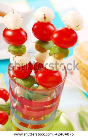 shashlik with mozzarella balls,cherry tomatoes and olives