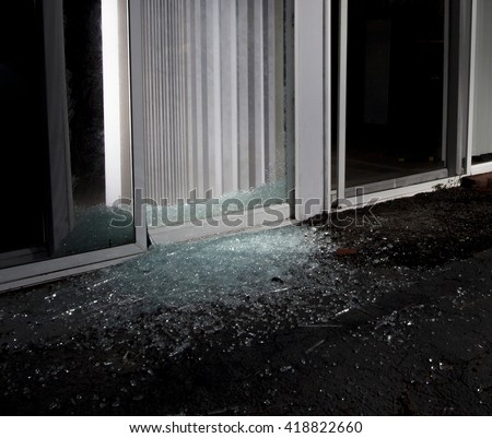 Shattered glass door after a burglar attempted to break in - stock photo