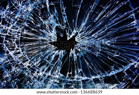 shattered glass with a hole in the middle