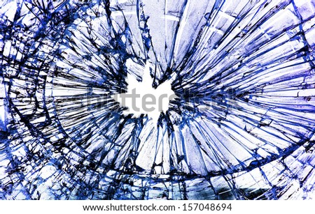 shattered glass with a hole in the middle                                - stock photo