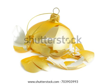 Shattered golden Christmas bauble (Christmas decoration) on white background