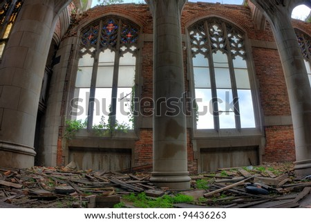 Shattered stained glass windows. Decaying ruins of the abandoned City Methodist Church in Gary, Indiana.