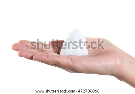 Shave foam (cream) on woman's hands