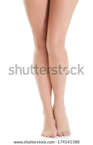 Shaved and smooth woman's long legs. Isolated on white.