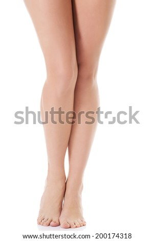 Shaved and smooth woman's long legs. Isolated on white. - stock photo