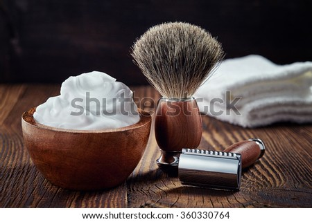 Shaving accessories on wooden background - stock photo