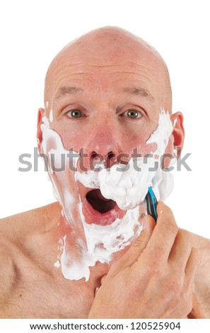 Shaving bald man with razor and foam