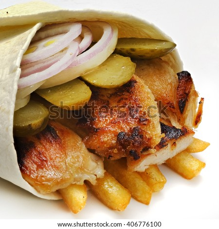 shawarma with meat and vegetables on white background