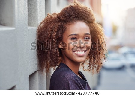 She brings beauty to the city - stock photo