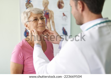 She has problems with sore throat - stock photo