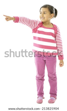 She is a cute girl who is lokking to the side and is pointing with her finger . - stock photo