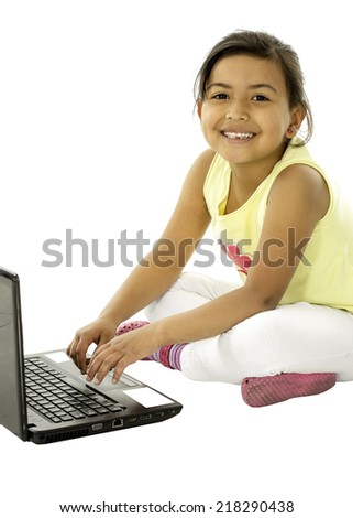 She is a cute girl who is studying on the computer. - stock photo