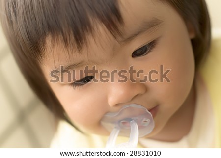 She is an one years old asian baby. - stock photo
