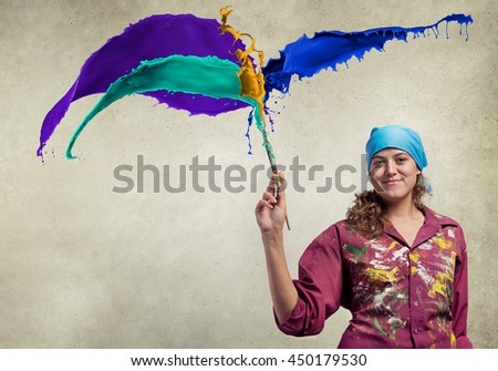 She is painting her world - stock photo