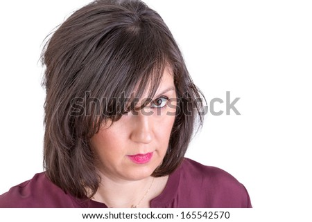 She looks in to your eyes very analytically, are you sure  you are telling the truth, she might be the boss, wife perhaps mother - stock photo