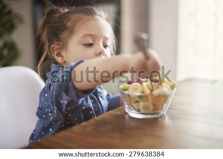 She loves eat fresh fruit  - stock photo