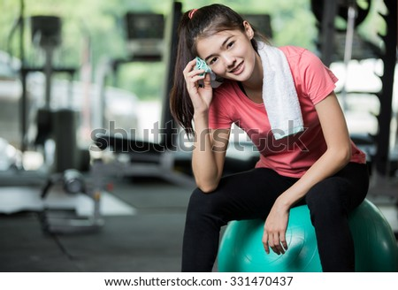 She tired from the workout.fitness woman in gym resting on pilates ball