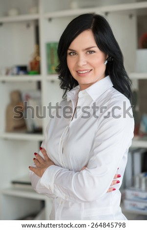 She work in start up office. Portrait of white collar worker in office