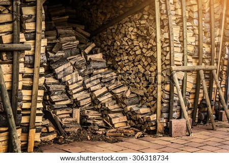 Shed with fire wood for the fireplace - stock photo